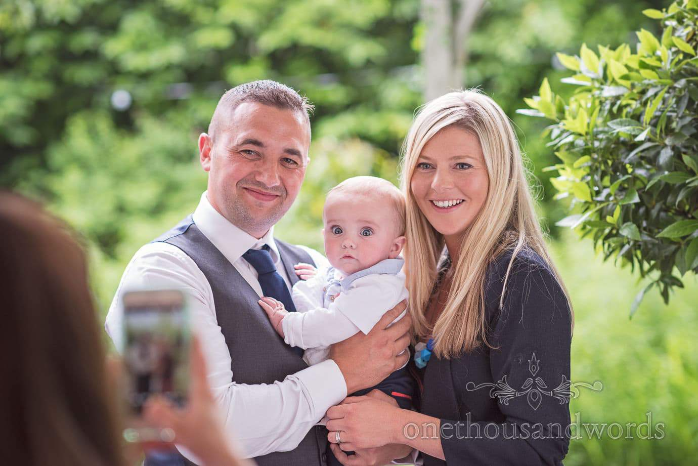 Wedding guests with baby family portrait at The Old Vicarage Wedding venue in New Forest