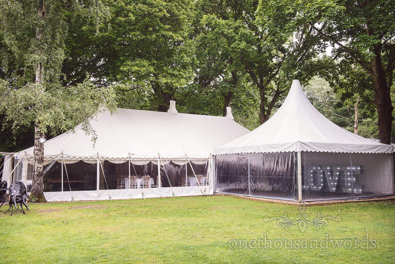 White wedding marquee in the woods with love lights at The Old Vicarage wedding