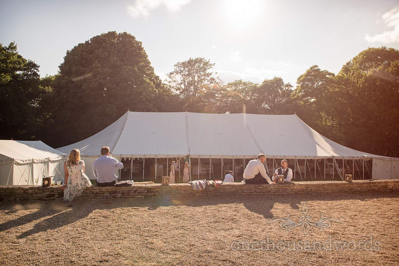 White wedding marquee photograph in countryside summer sun with trees