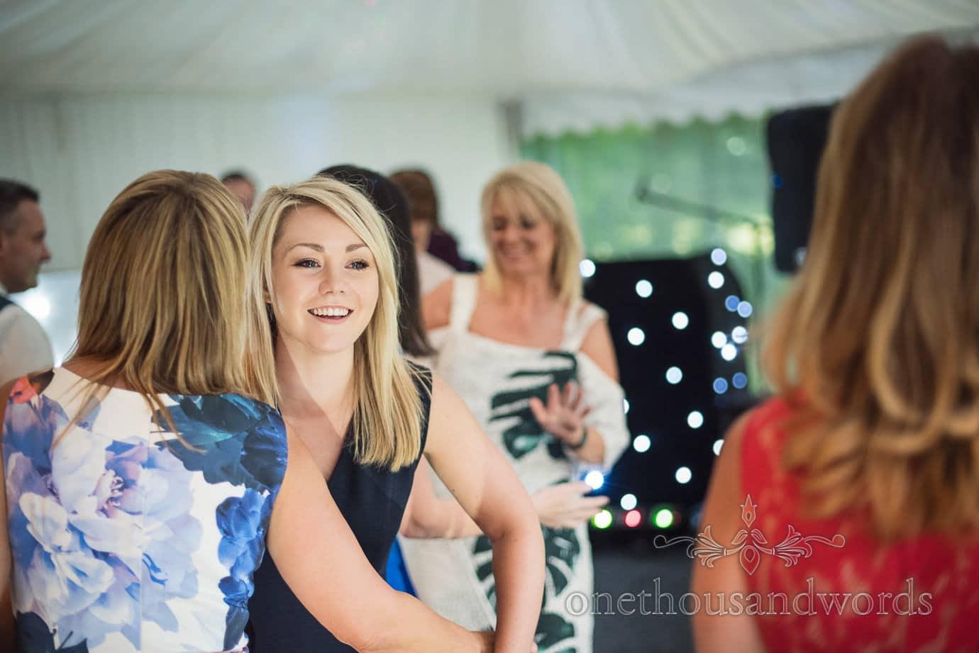 Young blonde wedding guests enjoys dancing at The Old Vicarage Wedding evening