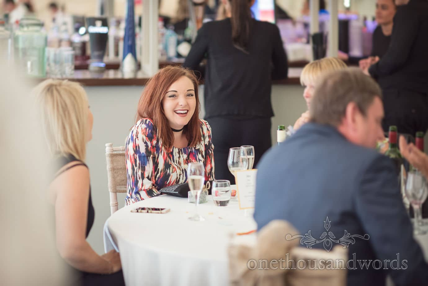 Yung red head wedding guest laughing at The Old Vicarage Wedding breakfast