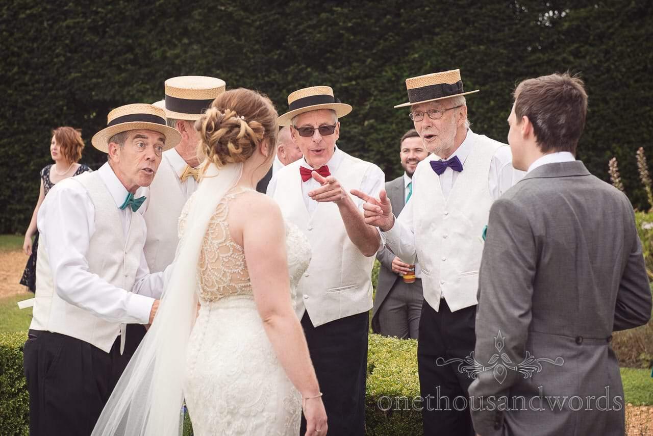 Barbershop quartet sing to bride at Lulworth Castle Wedding Photographs