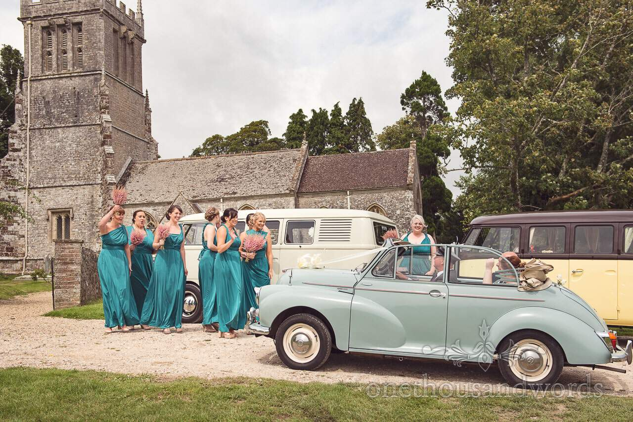 Bride and father arrive in classic Morris at Lulworth Castle Wedding Photographs