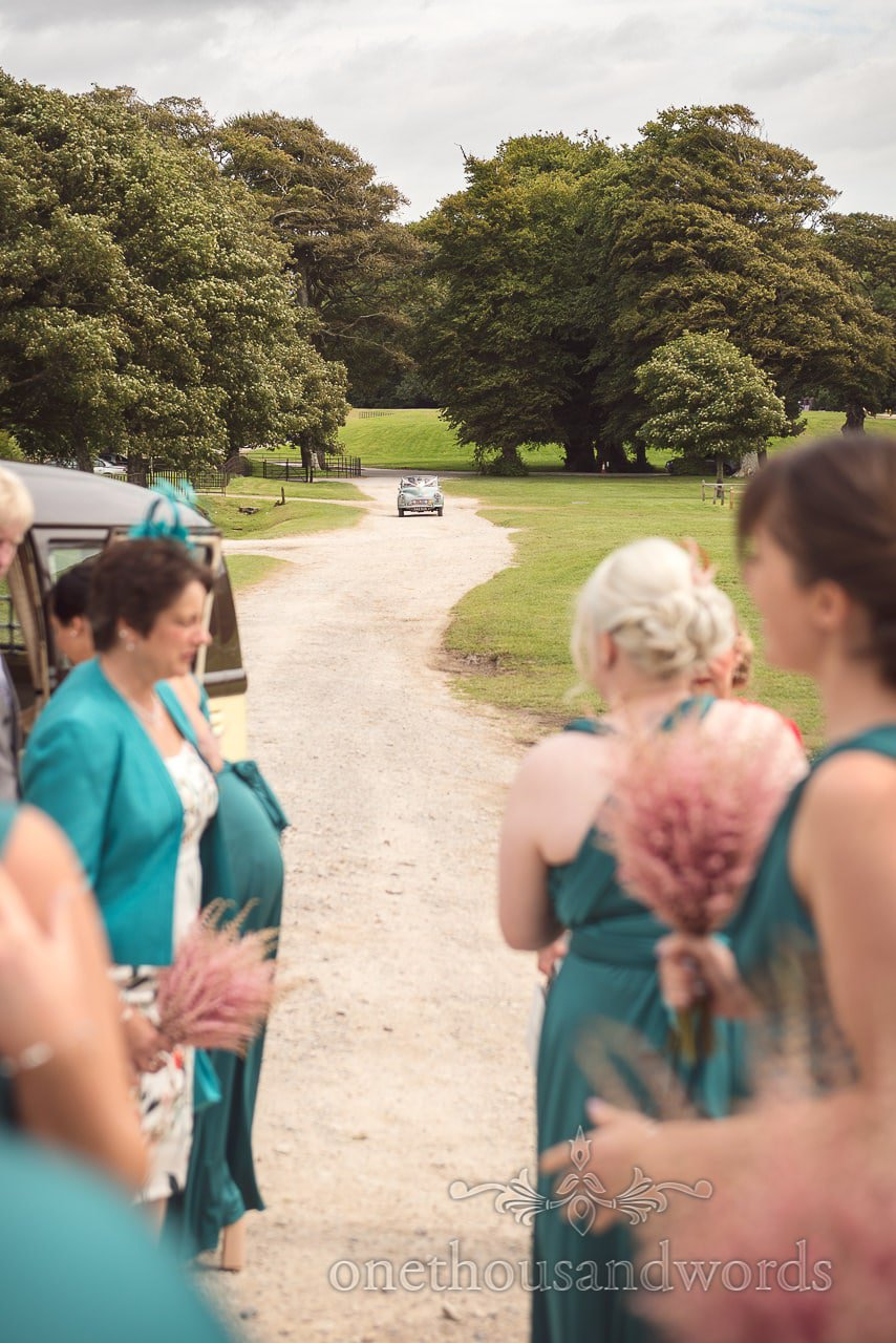 Bride and father arrive in classic Morris wedding car at Lulworth Castle Wedding Photographs