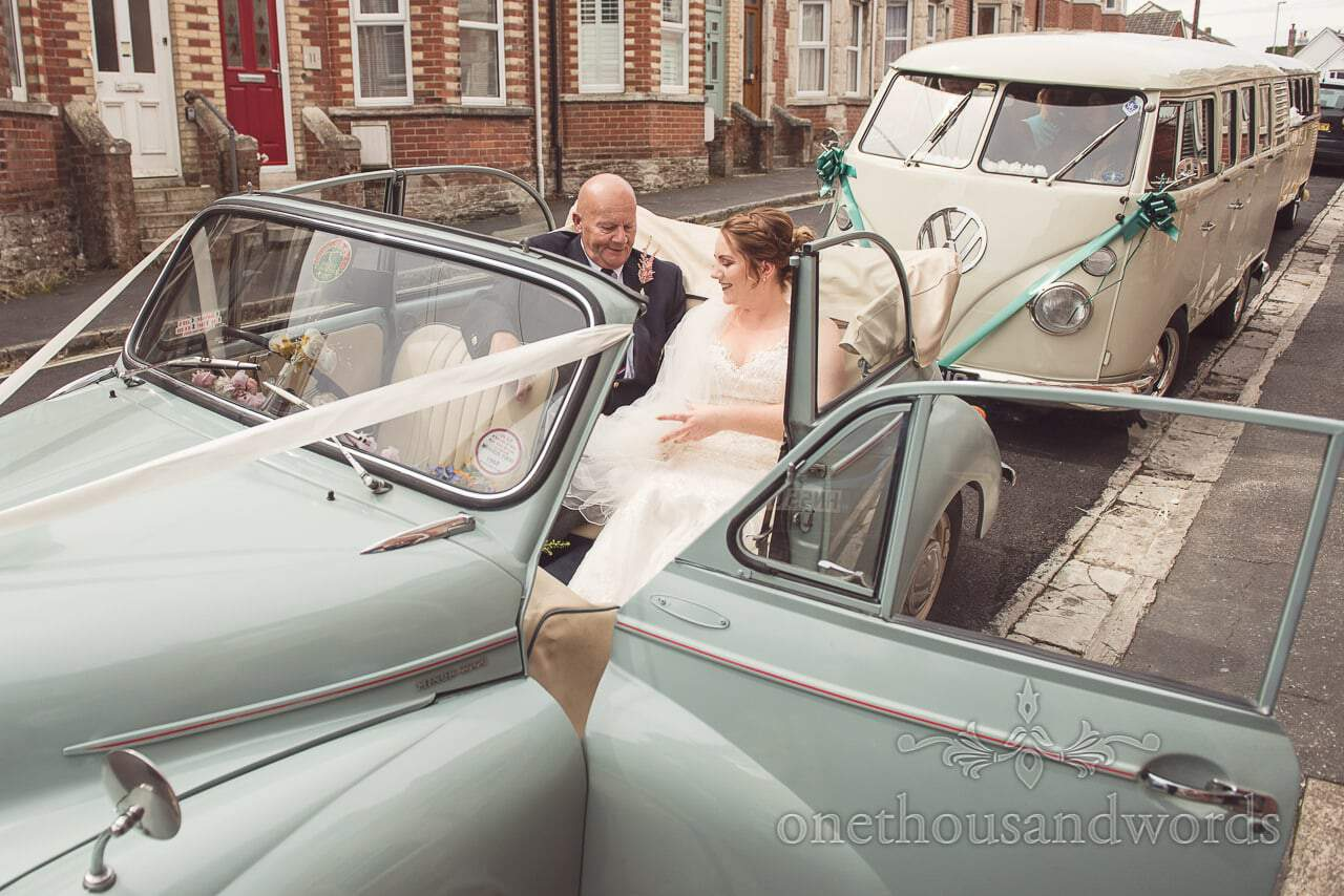 Bride and father in wedding car with VW Camper van