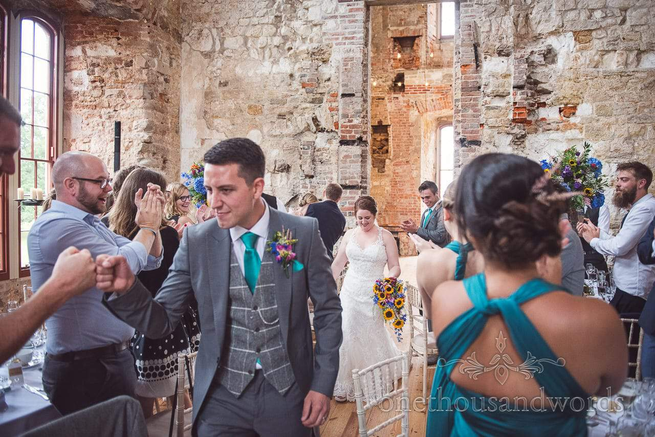 Bride and groom enter Lulworth Castle Wedding breakfast to standing ovation