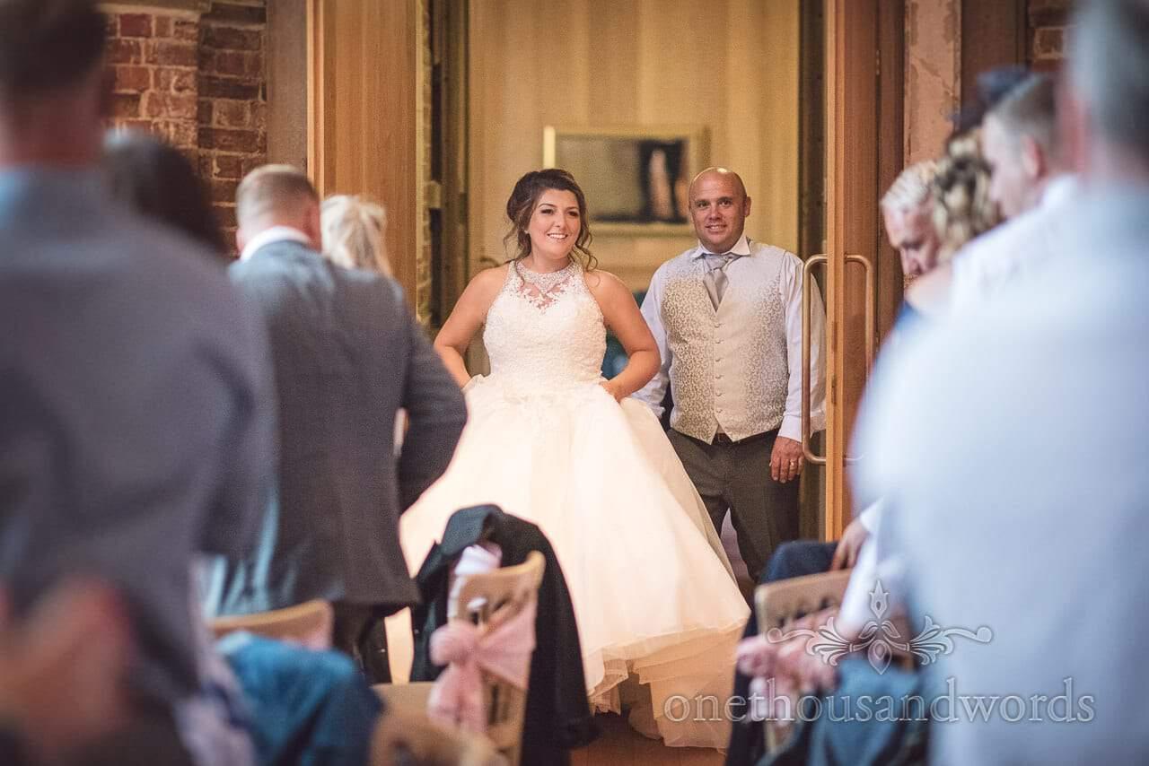Bride and groom enter wedding breakfast at Highcliffe Castle Wedding Photographs