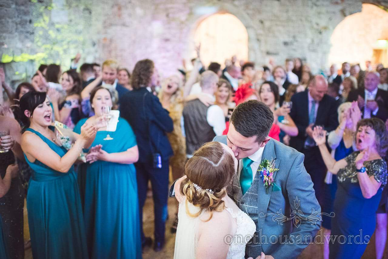 Bride and groom kiss during first dance at Lulworth Castle Wedding Photographs