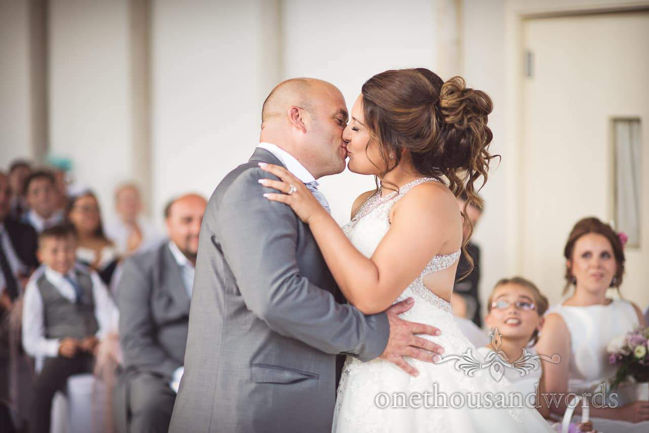 Bride and groom's first kiss at Highcliffe Castle Wedding Photographs