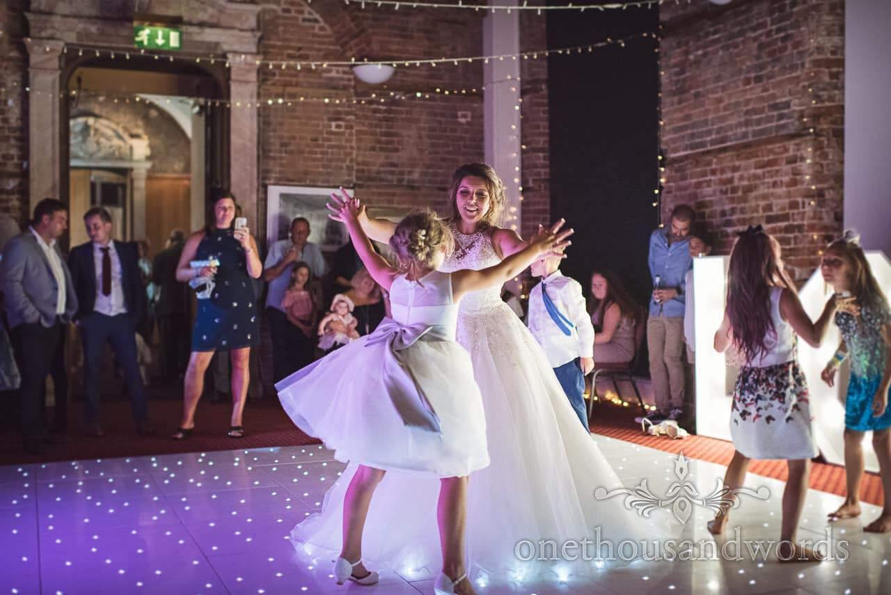 Bride dances with daughter on star dance floor at Highcliffe Castle Wedding