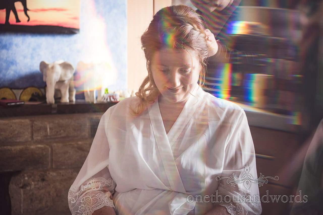 Bride had hair styled on morning of Lulworth Castle Wedding Photographs