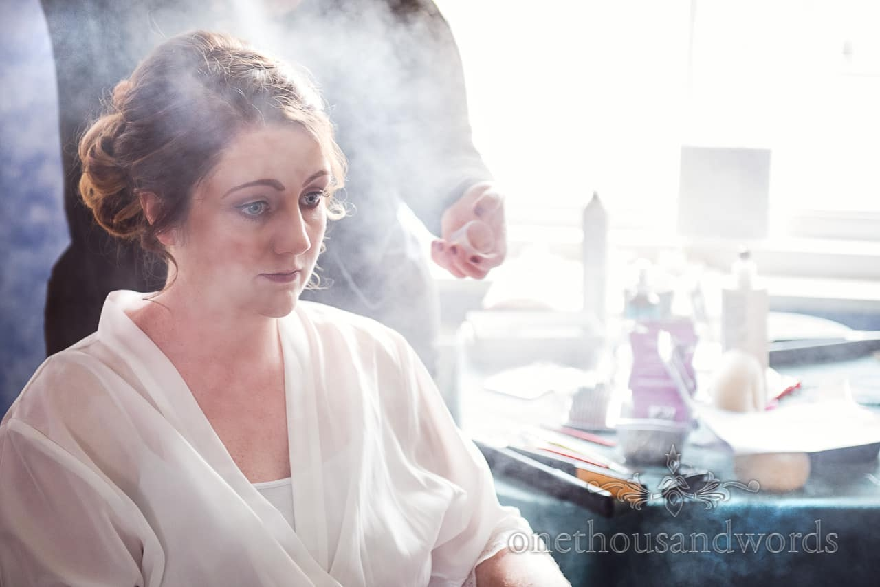 Bride in cloud of hairspray from Lulworth Castle Wedding Photographs