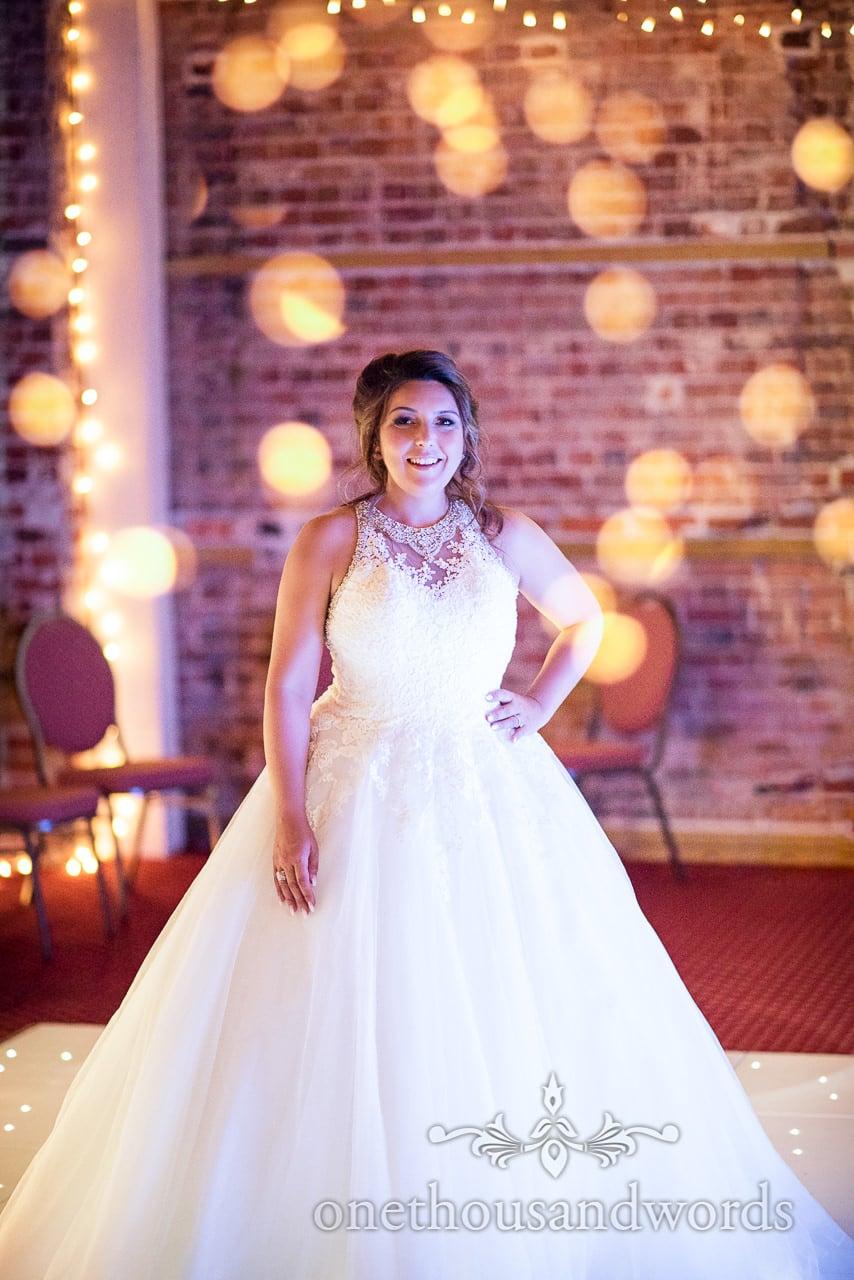 Bride in wedding dress on dance floor with fairy lights at Highcliffe Castle Wedding