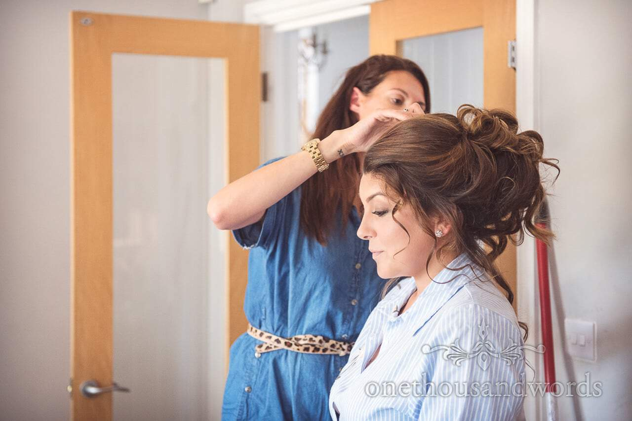 Bride is picture of calmness has wedding hair styled on wedding morning in Dorset