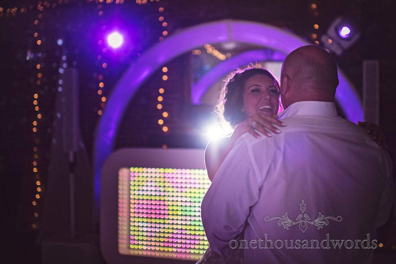 Bride laughs during first dance at Highcliffe Castle Wedding Photograph