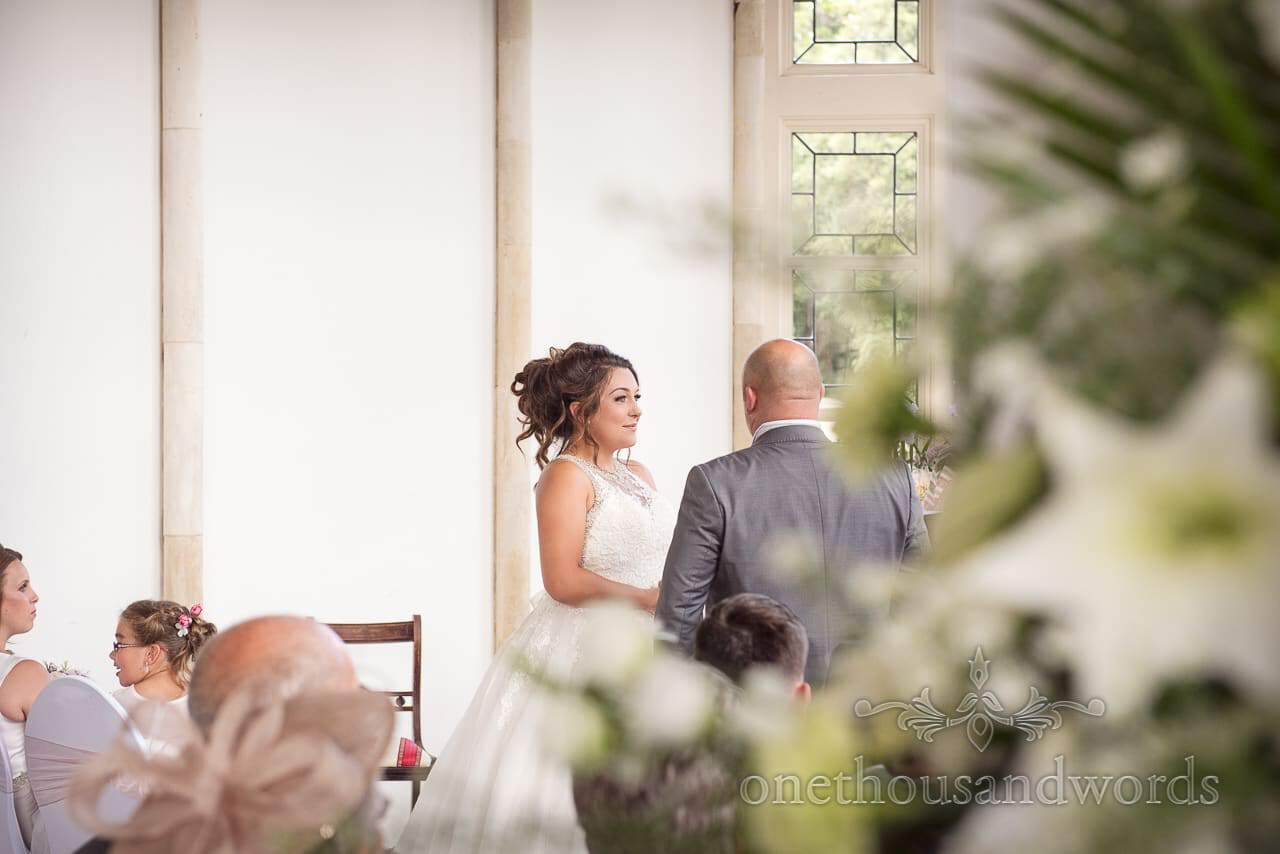 Bride makes her vows at Highcliffe Castle Wedding Photographs by one thousand words
