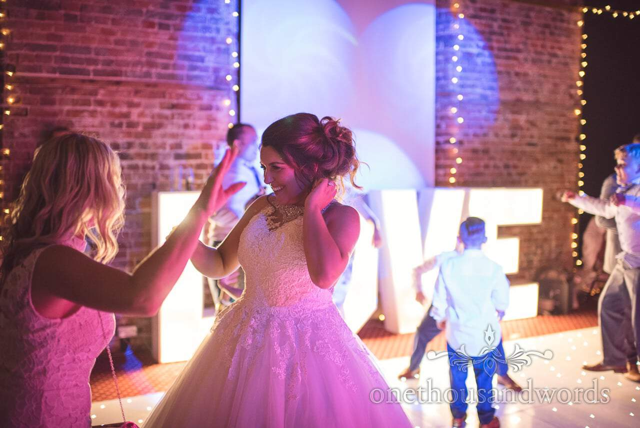 Bride on dance floor with friend at Highcliffe Castle Wedding Photographs