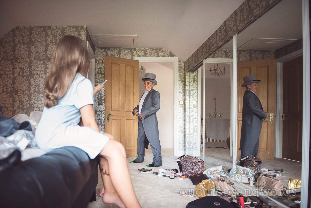 Bride's son shows off grey tail suit and top hat on wedding morning