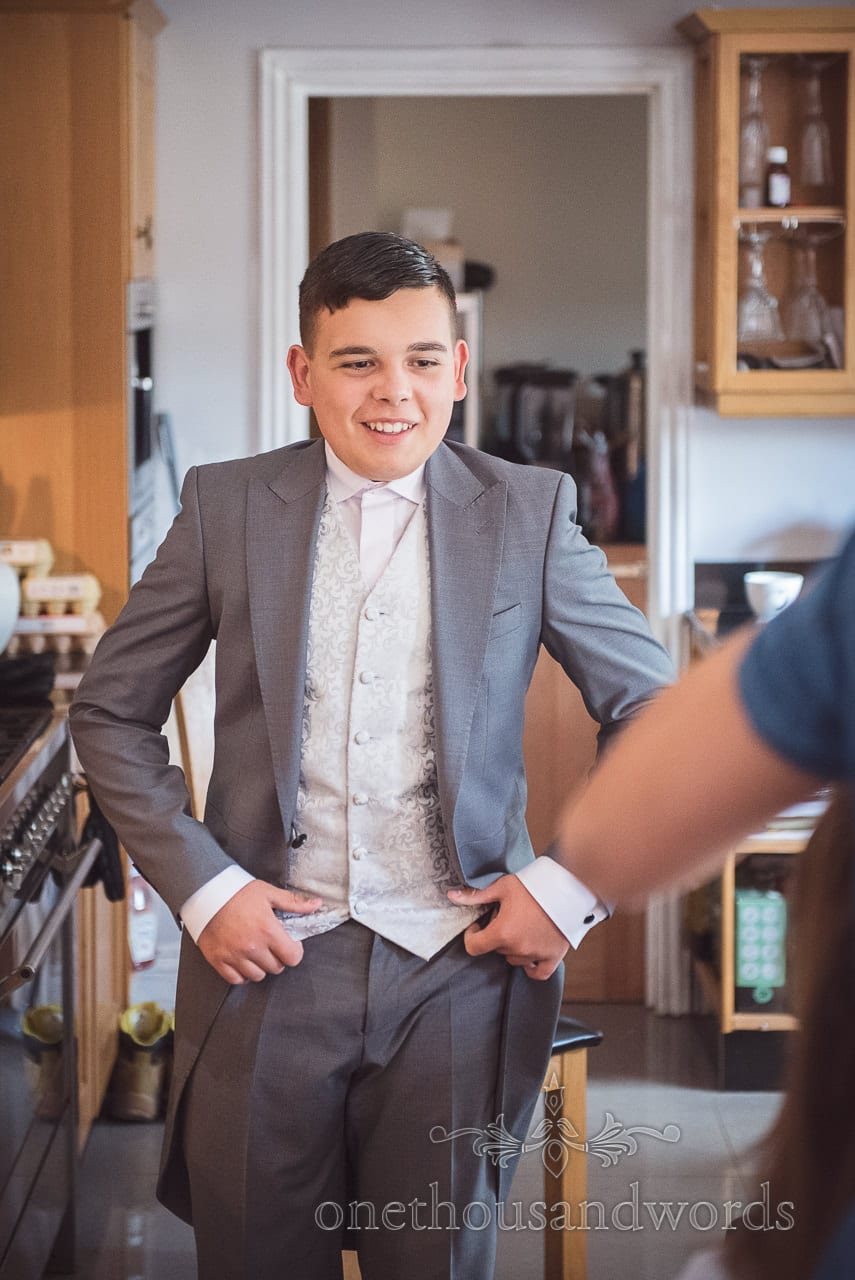 Bride's son wears grey tail suit and patterned waist coat on wedding morning