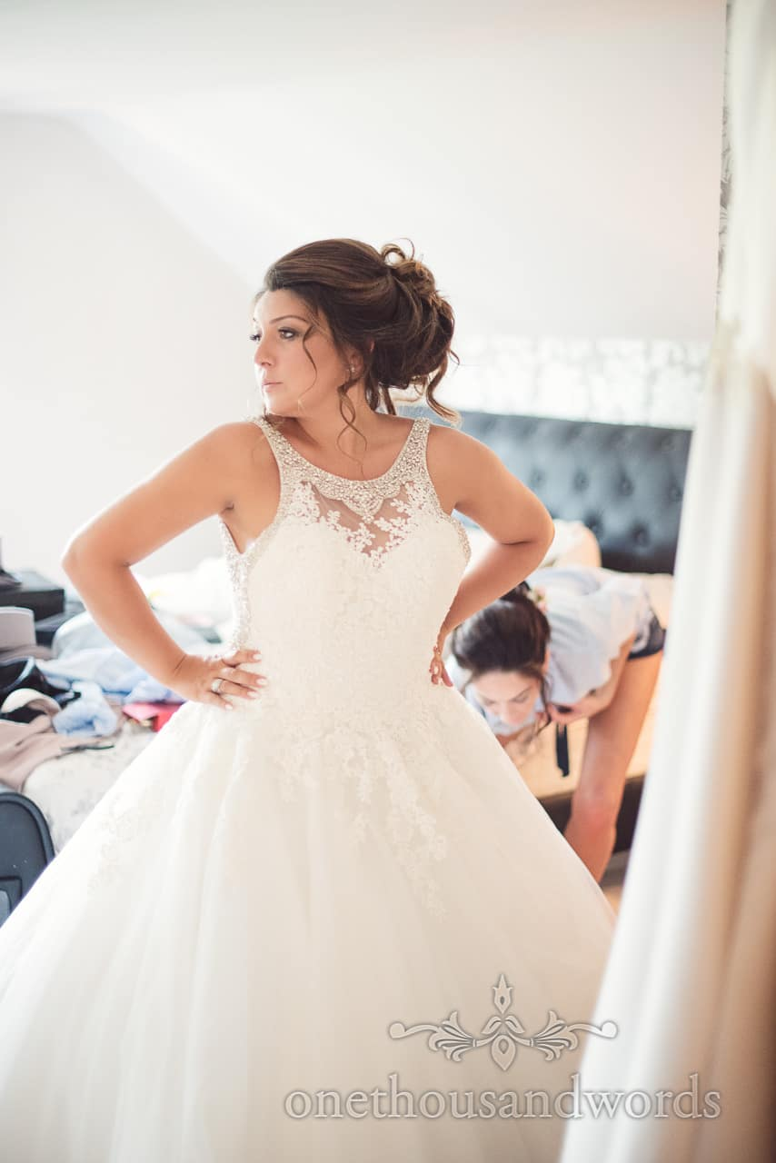Bride sees herself in wedding dress in a mirror for the first time on wedding morning