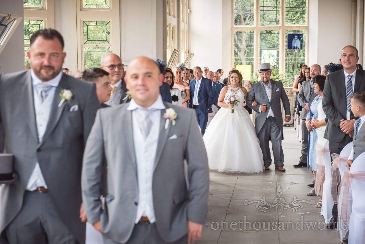 Bride walked down the aisle by her brother at Highcliffe Castle Wedding Photographs