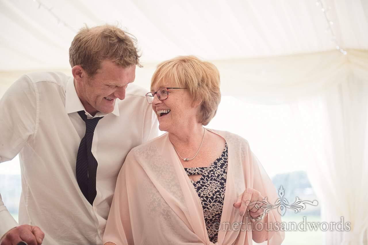 Brides brother and mother during marquee wedding reception