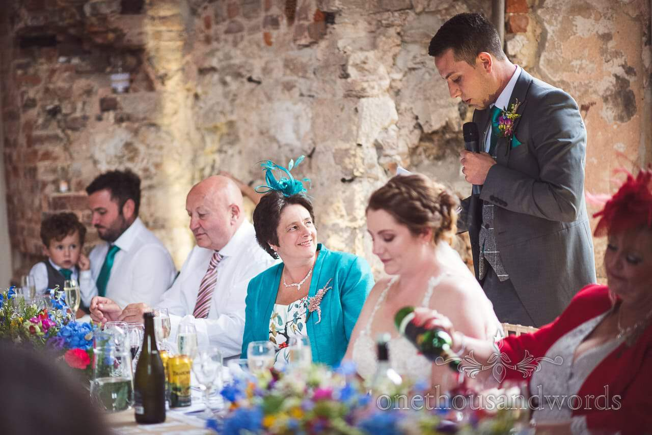 Brides mother looks at groom during his wedding speech at Lulworth Castle Wedding
