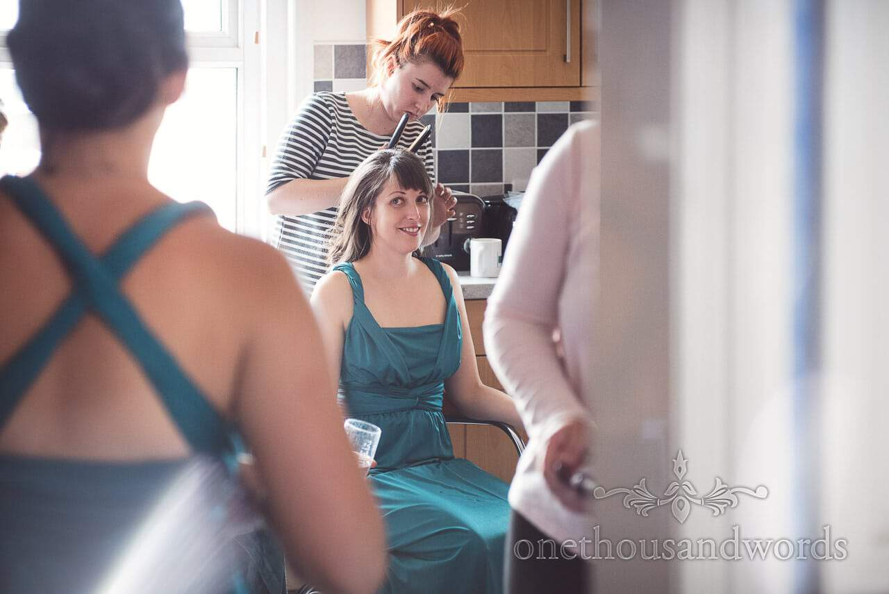 Bridesmaid has hair styled on morning of Lulworth Castle Wedding Photographs