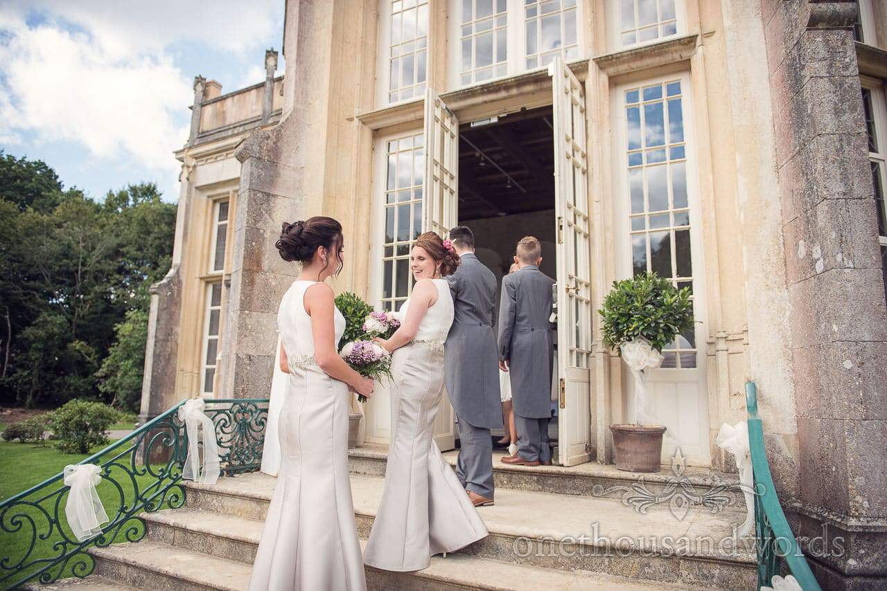Bridesmaids and page boys enter Highcliffe Castle Wedding ceremony