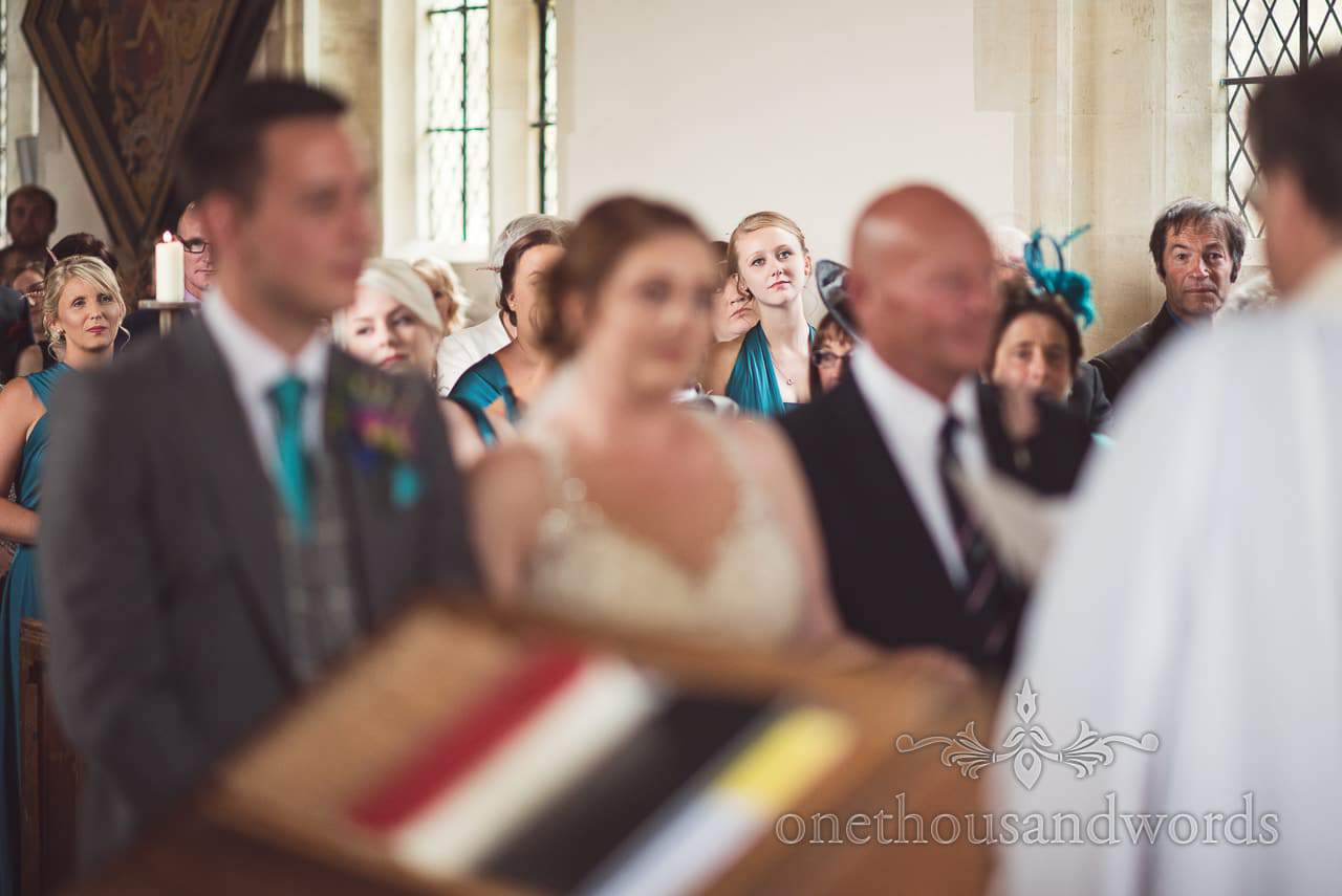 Bridesmaids look on during wedding ceremony at Lulworth Castle Wedding Photographs