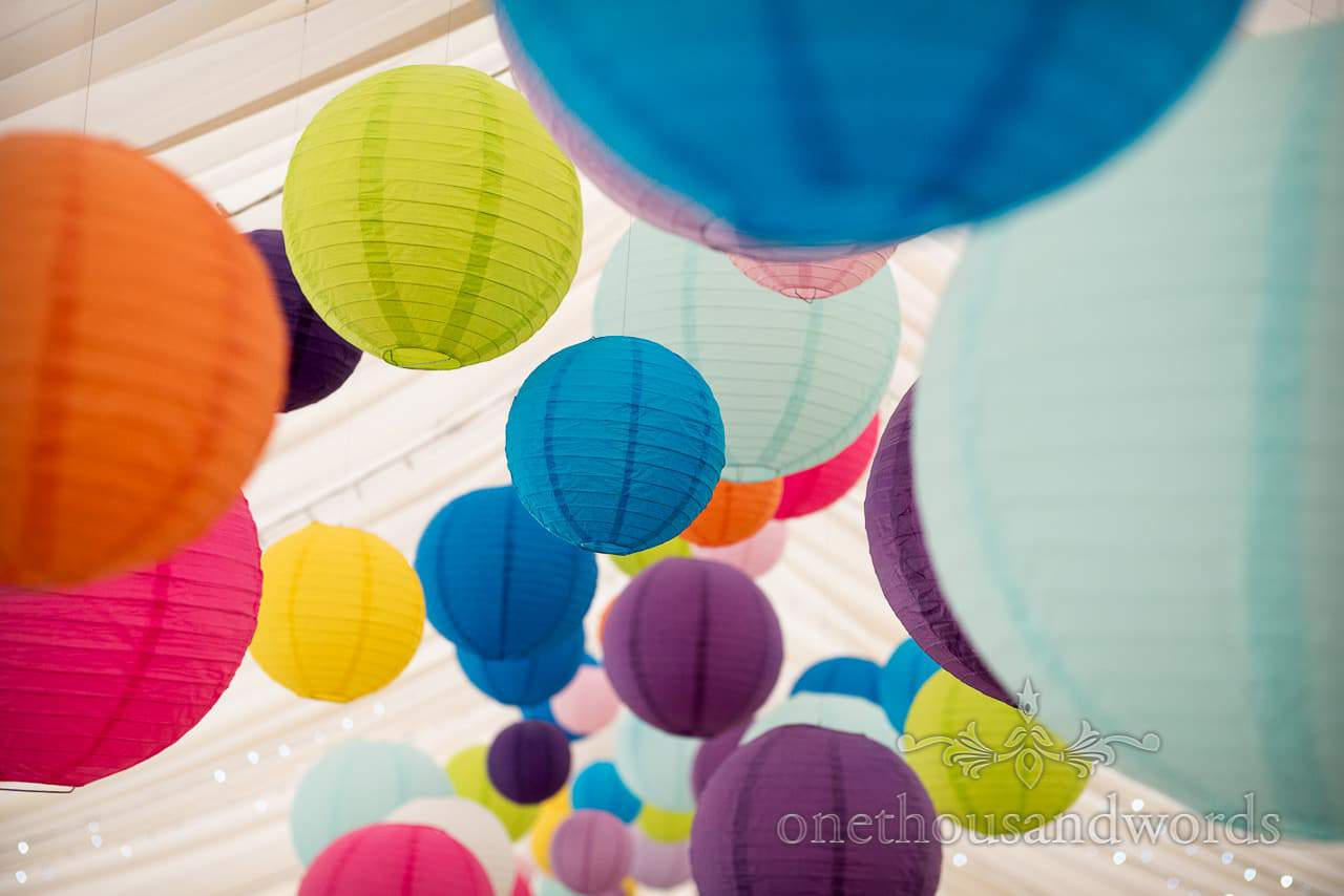 Brightly coloured Chinese lanterns photographs in wedding marquee