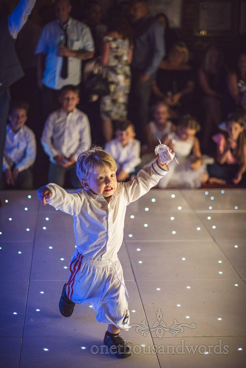 Child wedding guest invades the dance floor at Highcliffe Castle Wedding