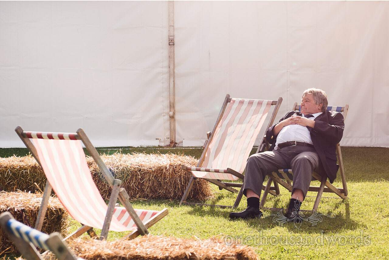 Chilling out on deckchair in the sun during marquee wedding reception