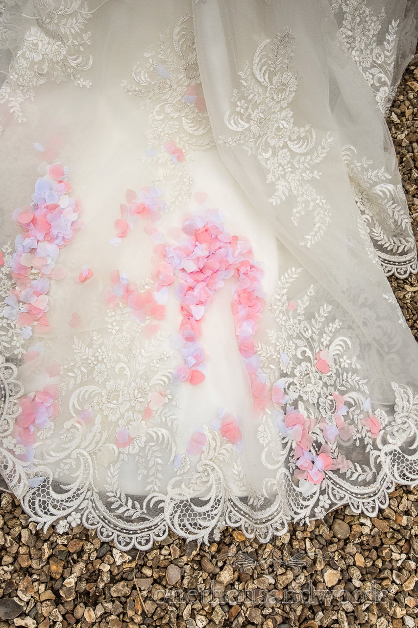 Confetti and detail of wedding dress at Lulworth Castle Wedding Photographs