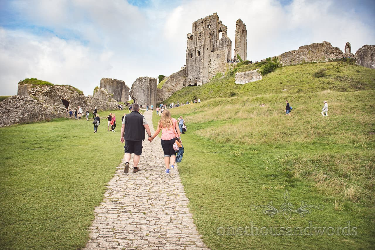 Corfe Castle wedding venue in Dorset engagement photo shoot by one thousand words