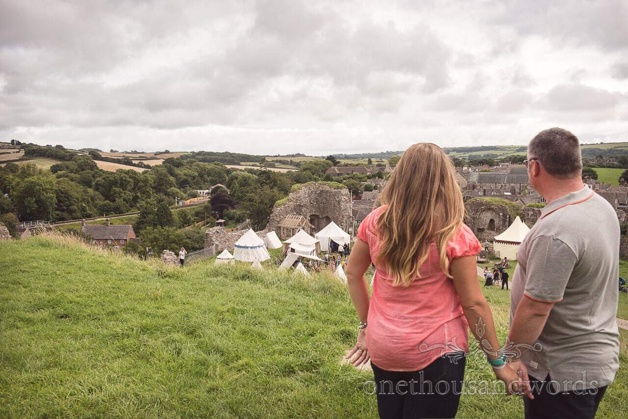 Engaged couple enjoy view over Purbeck from Corfe Castle engagement photo shoot