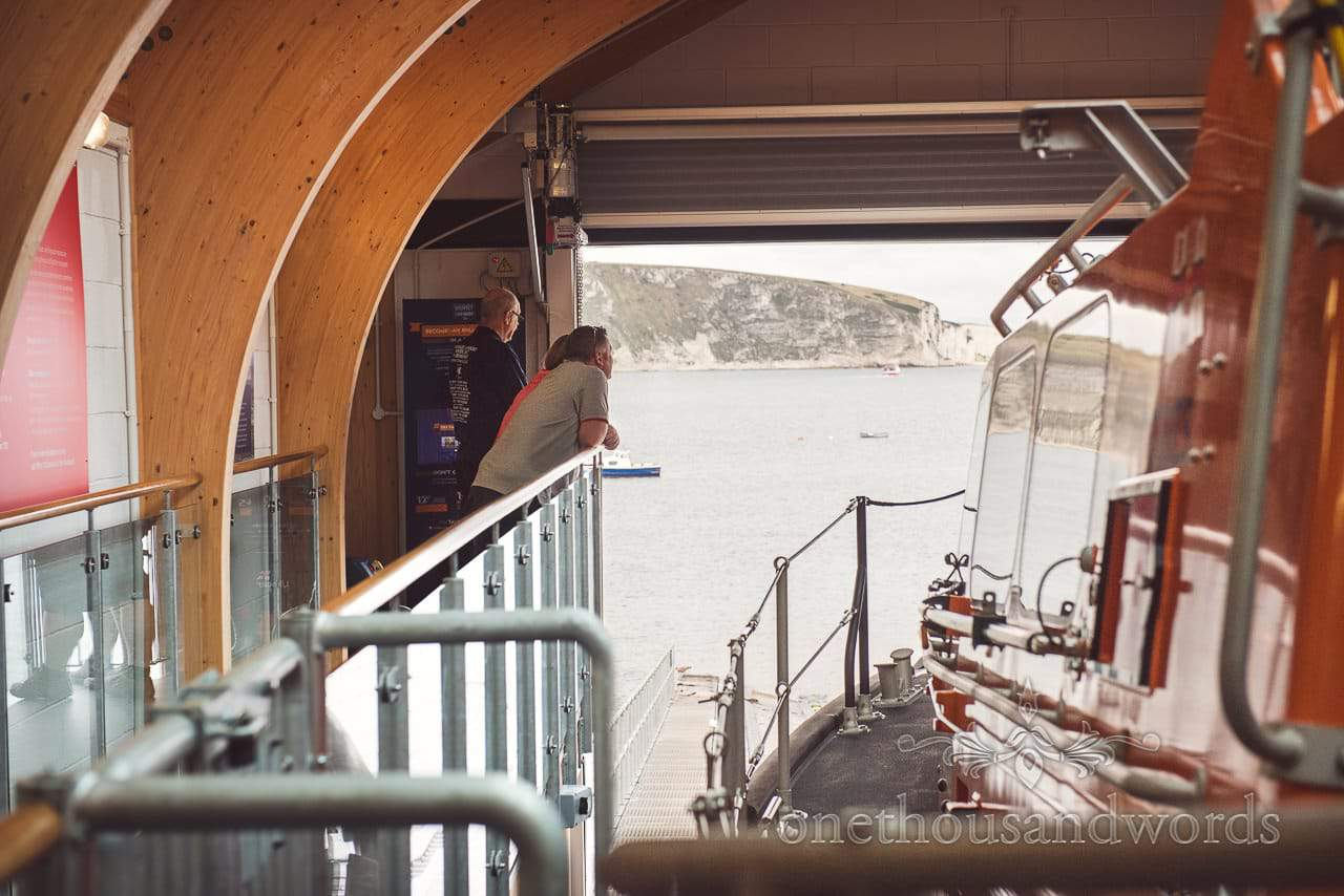Engagement Photo shoot couple have guided tour of Swanage Lifeboat Station in Dorset
