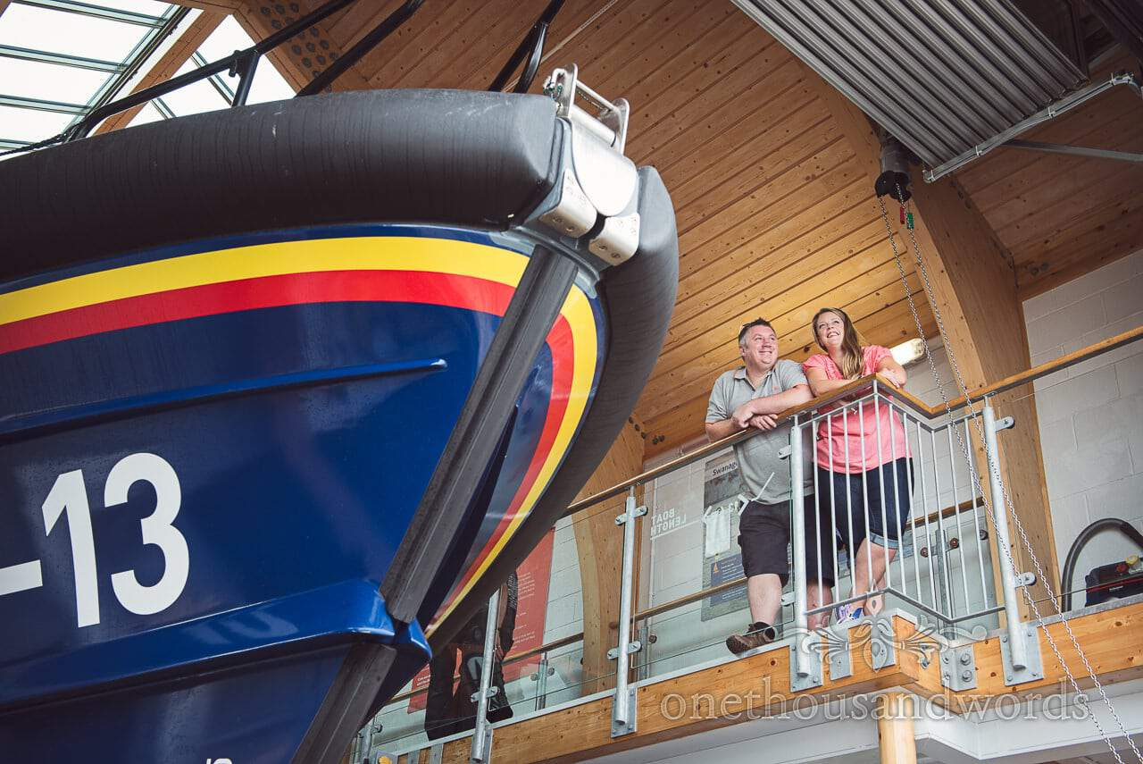 Engagement photo shoot couple look at Swanage Lifeboat and new lifeboat station