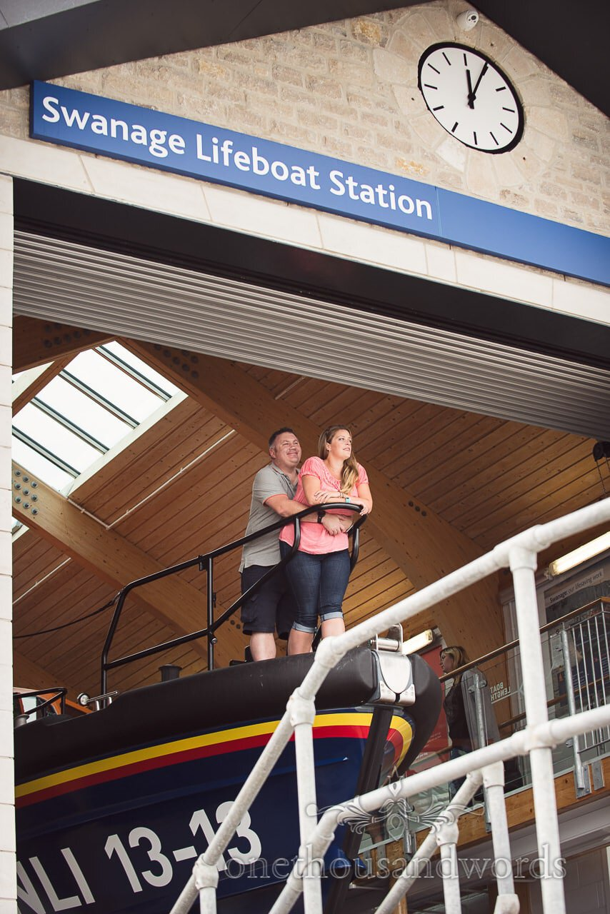 Engagement photo shoot couple look out from Swanage RNLI Lifeboat Station