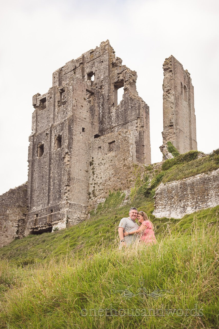 Engagement Photograph of couple hugging in Corfe Castle wedding venue in Dorset