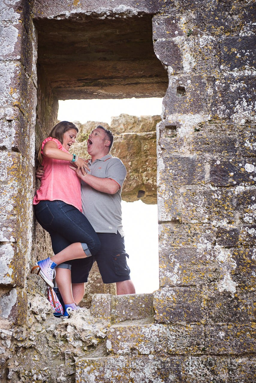 Engagement Photograph of groom to be getting carried away at Corfe Castle