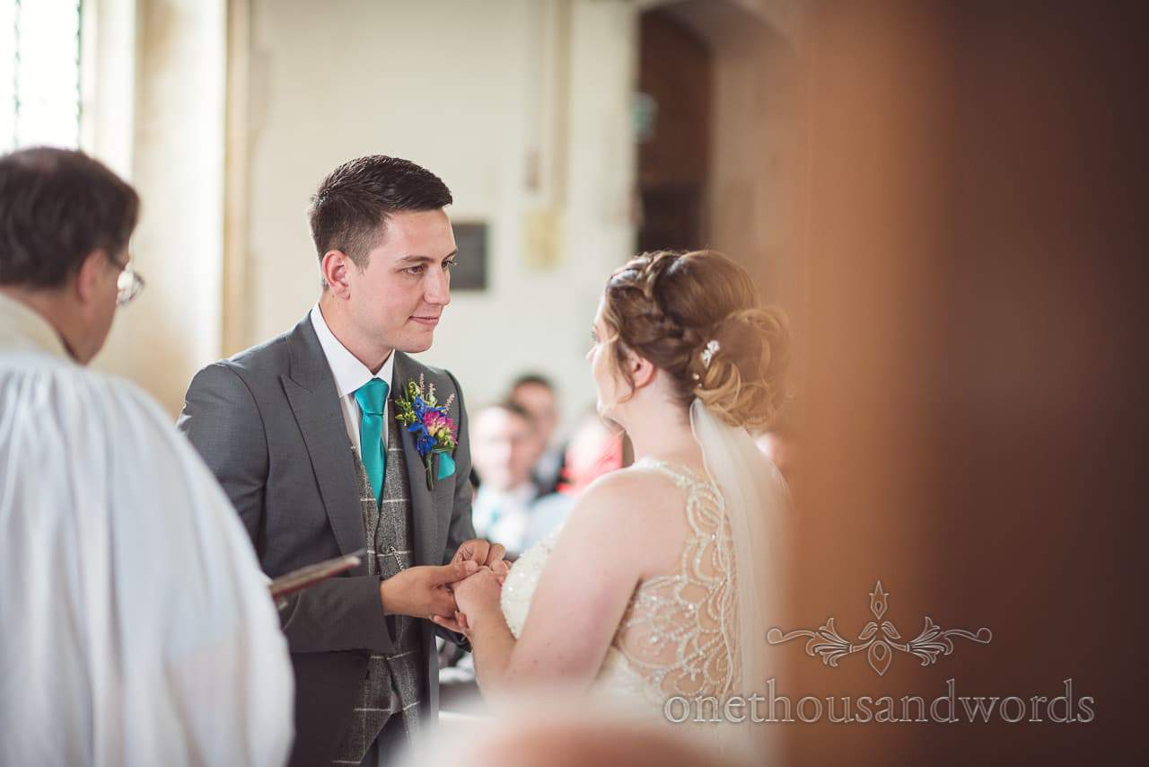Exchange of rings during Lulworth Castle Wedding Photographs