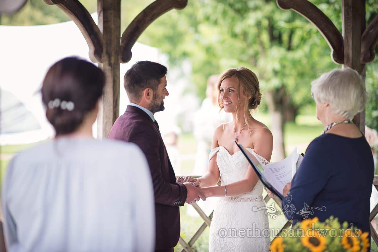 Exchange of vows during Morten walled Gardens Wedding pavilion ceremony photograph