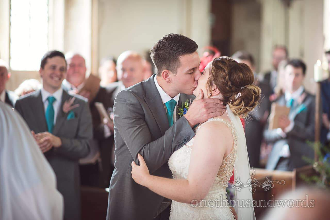 First kiss during wedding ceremony at Lulworth Castle Wedding Photographs