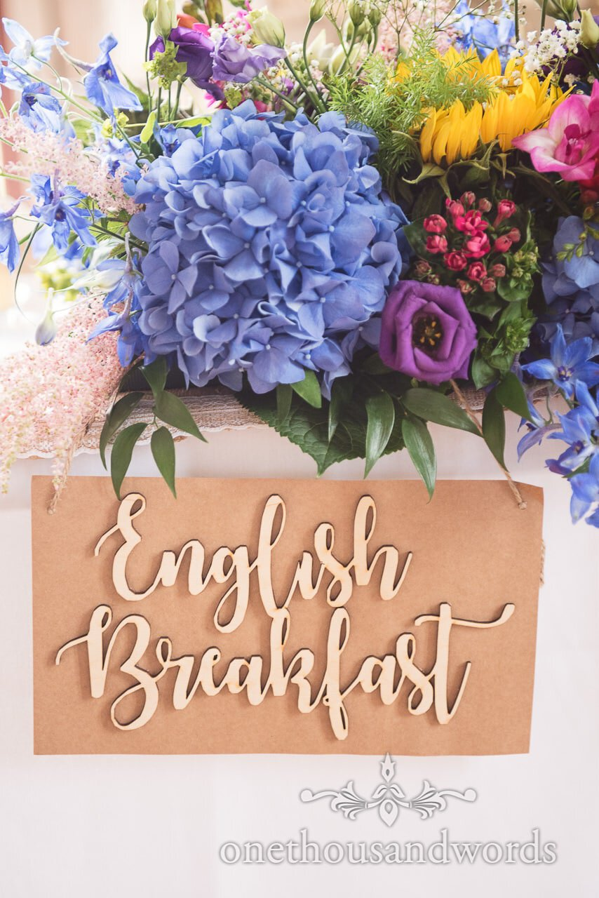 Floral table decoration with table name at Lulworth Castle Wedding Photographs