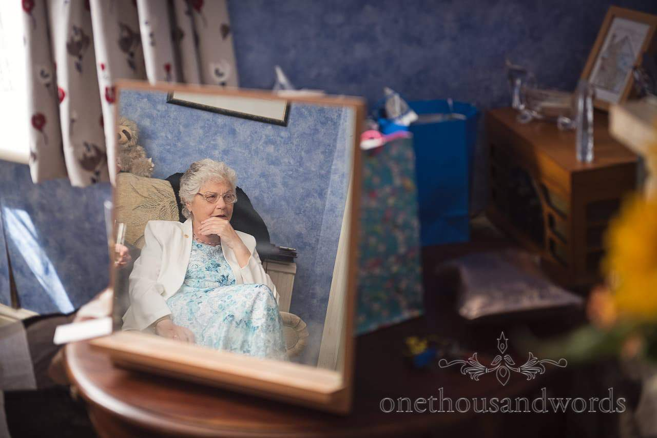 Grandmother in mirror on morning of Lulworth Castle Wedding Photographs