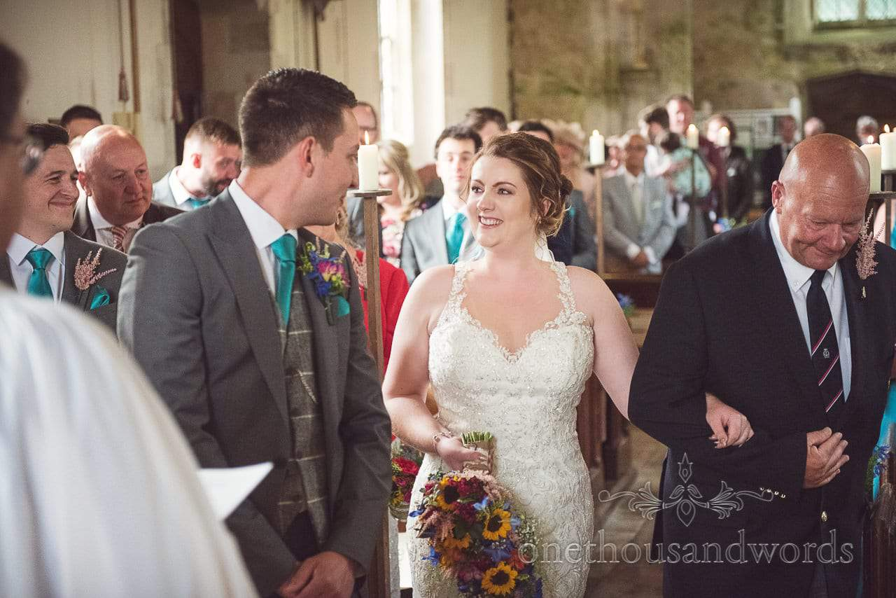 Groom greets bride at church ceremony at Lulworth Castle Wedding Photographs