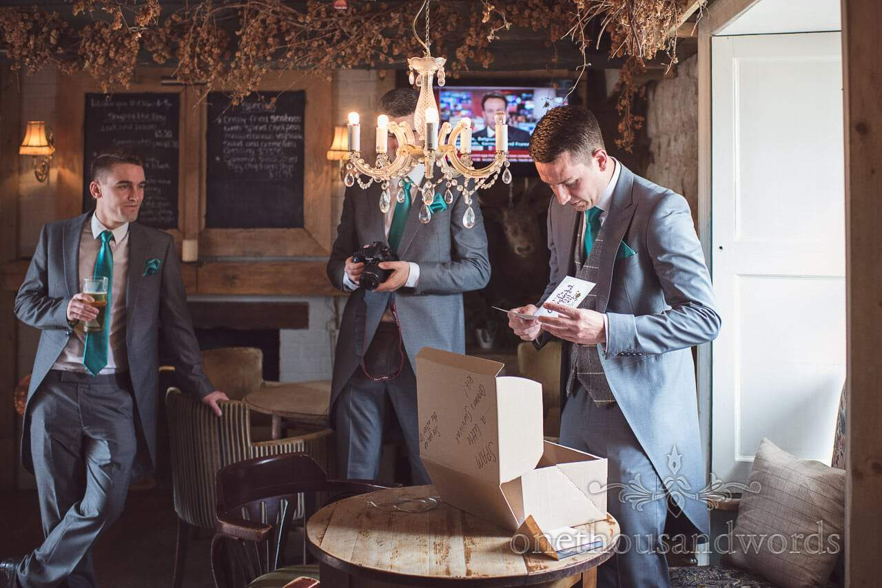 Groom receiving gifts on morning of Lulworth Castle Wedding Photographs
