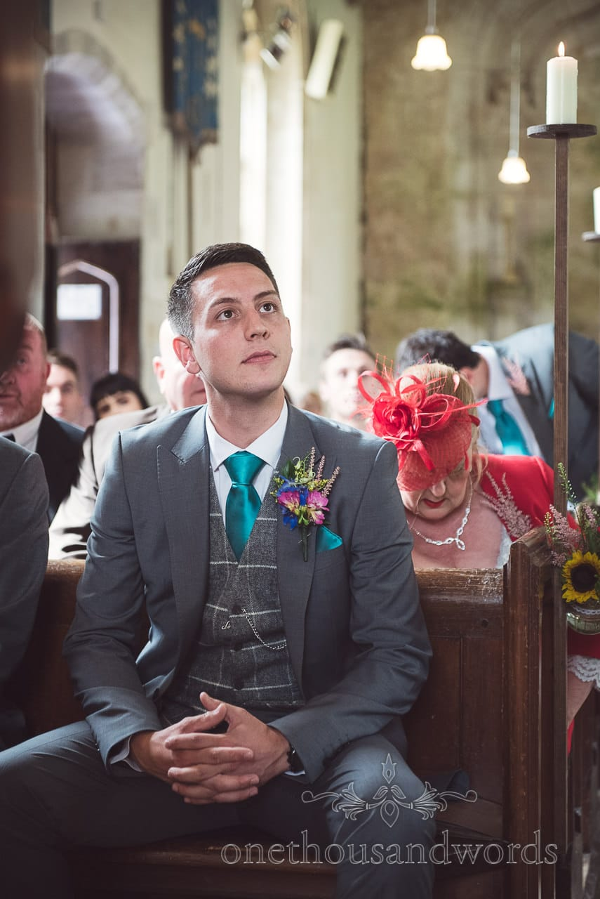 Groom waits patiently for his bride at Lulworth Castle Wedding Photographs