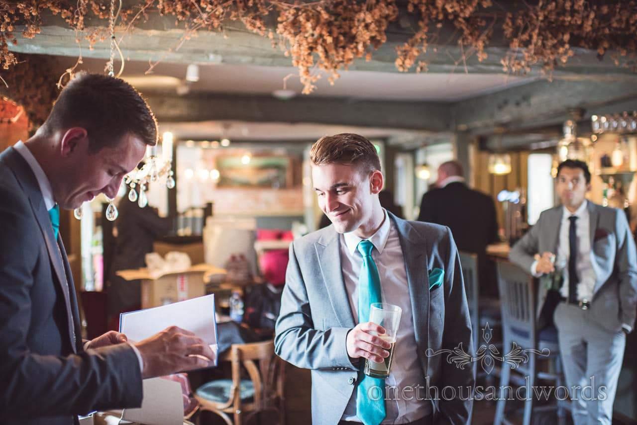 Groom with groomsman in pub on morning of Lulworth wedding